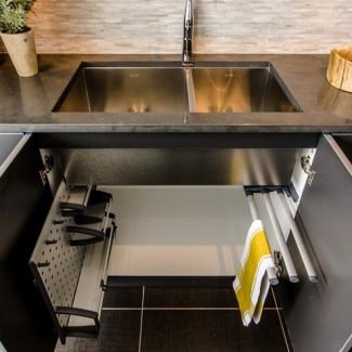 Storage designed by Ateliers Jacob for cabinets below the sink