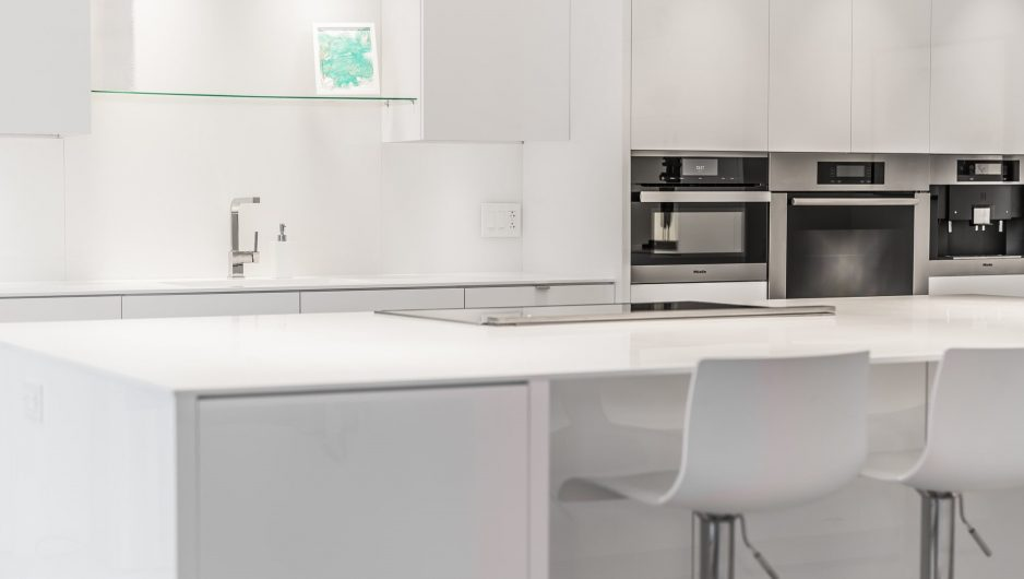 white kitchen with plenty of storage space.